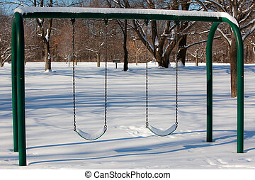 Snow Covered Swing Set - A winter scene of a snow covered...