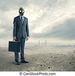 pollution concept: portrait of businessman in a gas mask...