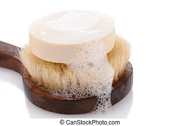 Bar of Soap on a Bath Brush - A bar of soap with lather on a...