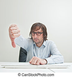 Thumb down - Casually dressed business man showing thumb...