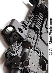 Modern tactical laser sght on assault carbine close-up. -...