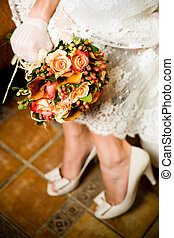 Close-up shot of bride holding bouquet