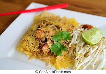 Phad Thai - Famous Thai noodle with shrimp covered with...