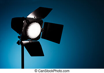 Studio spot light on blue background