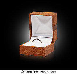 white gold ring with diamond in box on black background