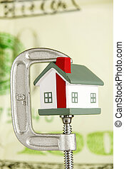 Housing Market - Grip holding a house portraying the housing...