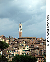 Siena - panorama of the old part of town with a slender tower, Torre del Manga