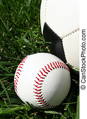 Baseball and Soccerball - Baseball and soccerball sitting on...