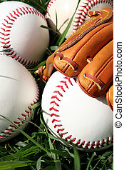 Baseballs and Glove - A baseball glove surrounded by balls...