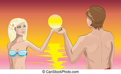 Couple in love on the beach at suns
