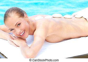 Relaxed woman taking spa treatment