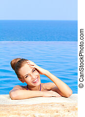 Cute in swimming pool with copy space - Close up of cute...