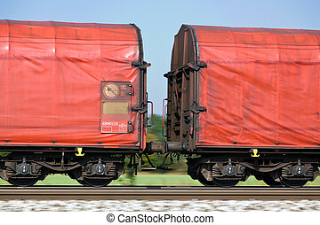 freight train on rails - the wagons of a freight train on...