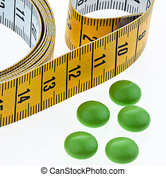 tape measure and tablets, as a symbol for diet pills remove