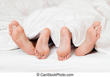 feet of a couple in bed - dents a couple feet in bed love,...