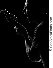 sing to me , guitar - black and white of caucaision male...
