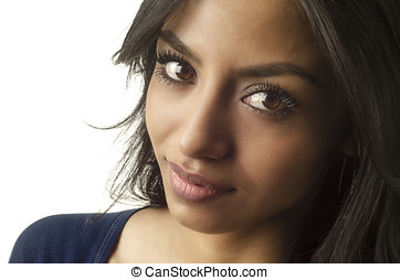 Face of pretty young woman isolated against white
