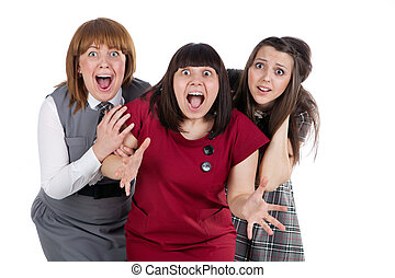 Three surprized girls with opened mouth. Isolated on white.
