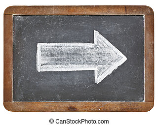 white arrow on blackboard - arrow - white chalk drawing on a...