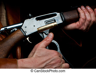 rifle man - close up of a round bring ejected form a...