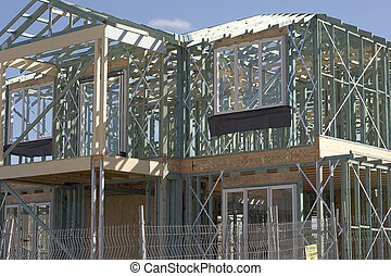 Frame Work For New House - Frame work being built for a new...