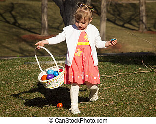 Toddler on Easter Egg Hunt - Little toddler girl on Easter...