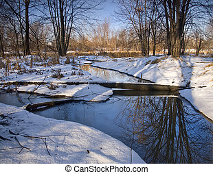 Winter Blue Stream - A stream of blue water winding through...