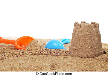 sandcastle and beach shovels on a white background