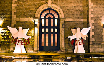 Joyeux Noel - Church entrance decorated for Christmas with...
