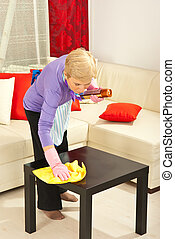 Woman wipe dust on the table - Woman wipe dust with cloth on...
