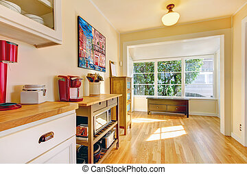 Kitchen corner with large window and bench - Yellow bright...