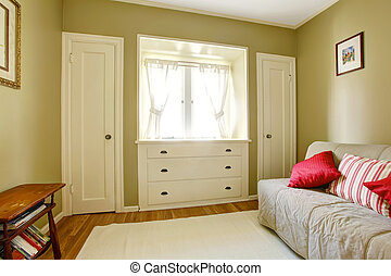 Green bedroom with white doors and dresser.