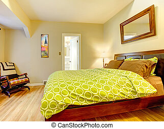Modern bedroom with bright green bed spread.