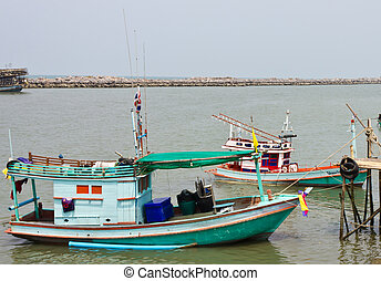 two fishing boats on the sea
