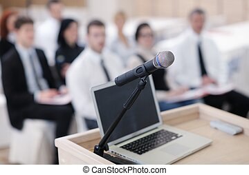 laptop on conference speech podium - business laptop and...