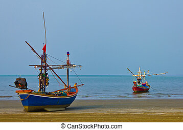 two fishing boats at the sea