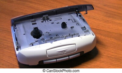 player - old cassette player, male puts tape