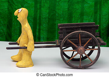 hand cart and clay cartoon figurine - Cartoon plasticine...