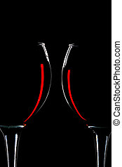 two glasses of red wine isolated over black