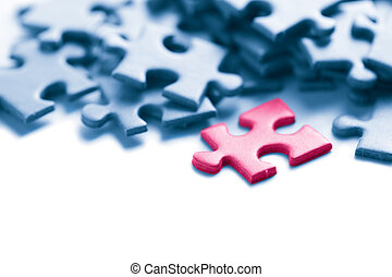 blue puzzle with one pink piece