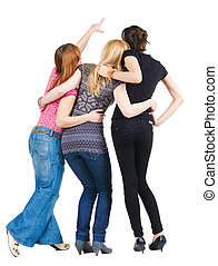 Back view of group young women pointing Girl looks into the...