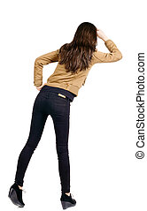 back view of standing beautiful brunette woman Young girl in...