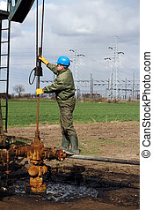 worker check oil pump - oil worker check oil pump