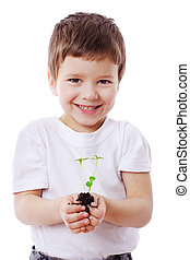 Boy with sprouts in hands - Smiling boy with sprouts in...