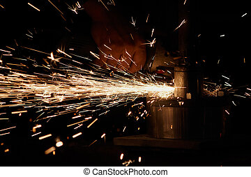 grinding - Man with a metal grinder grinding, sparks
