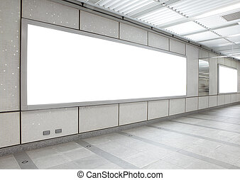 Blank billboard in the city building, shot in subway...