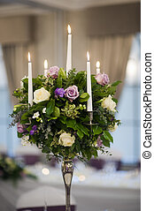 center piece table decoration with candles and flowers