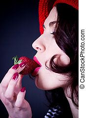 woman with strawberry in red beret