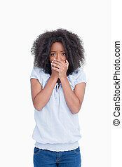 Young woman placing her hands on her mouth in surprise -...