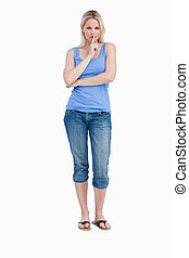 Blonde woman telling to be quiet while crossing her arms -...